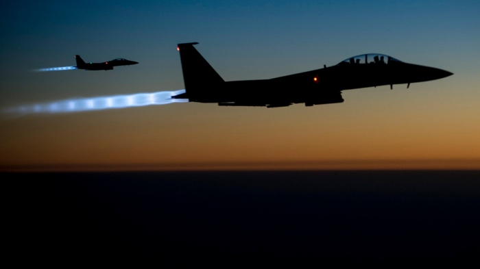 epa04422741 A handout picture made available by the US Department of Defense (DoD) on 29 September 2014 shows a pair of US Air Force F-15E Strike Eagles flying over northern Iraq early in the morning of 23 September 2014, after conducting airstrikes in Syria. These aircraft were part of a large coalition strike package that was the first to strike Islamic State (IS or ISIL) targets in Syria. Al-Nusra, a branch of al-Qaeda operating in Syria, was hit by US airstrikes on 23 September, the same day the US and allies launched raids against the Islamic State group, which split from al-Qaeda last year and has seized swathes of Syria and neighboring Iraq. The US Congress has also authorized the equipping and training of moderate Syrian rebel groups who are to fight Islamic State militants on the ground. But even some moderate rebel groups have reacted angrily to the strikes against al-Nusra, asking why they are not receiving more military aid and arguing that regime forces should also be targeted. The Britain-based Syrian Observatory for Human Rights said al-Jaulani's group lost 57 fighters in the raids. The US said it was targeting a network of al-Qaeda veterans who were preparing overseas attacks. US president Barack Obama blamed instability in Syria for giving extremists space to thrive. In an interview on 28 September, Obama said his director of national intelligence already had acknowledged that US intelligence underestimated what had been taking place in Syria. EPA/US AIR FORCE/MATTHEW BRUCH HANDOUT EDITORIAL USE ONLY