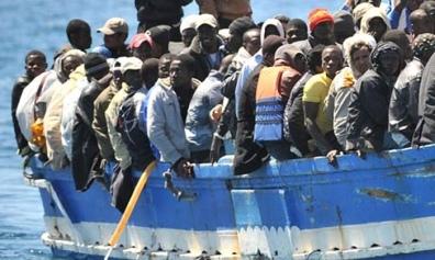 Nik - Migrants 1_text (Ettore Ferrari-EPA)